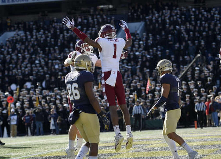 Temple wide receiver Ventell Bryant (1) celebrates his touchdown with tight end Colin Thompson, back, as Navy safety Daiquan Thomasson (26) looks on during the first half of the American Athletic Conference championship NCAA college football game, Saturday, Dec. 3, 2016, in Annapolis, Md. (AP Photo/Nick Wass)