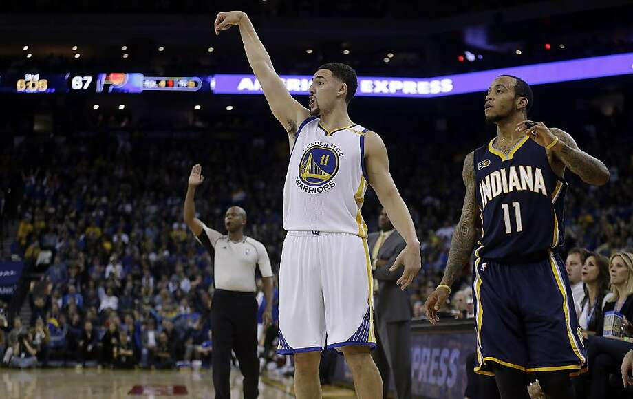 Golden State Warriors' Klay Thompson, left, follows through on a shot as Indiana Pacer's Monta Ellis, right, watches during the third quarter of an NBA basketball game Monday, Dec. 5, 2016, in Oakland, Calif. (AP Photo/Ben Margot) Photo: Ben Margot, Associated Press