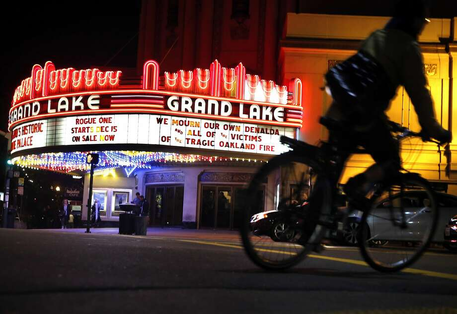 The Grand Lake Theater has updated its marquee with a message mourning the victims of the fire at the Ghost Ship warehouse, and especifically Nicole R. Siegrist, 29, who went by the name Denalda Nicole Renae, who is still considered missing, as recovery efforts continue in Oakland, Calif., on Monday, December 5, 2016. Photo: Carlos Avila Gonzalez, The Chronicle