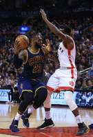 TORONTO, ON - DECEMBER 05:  Lebron James #23 of the Cleveland Cavaliers drives to the basket as DeMarre Carroll #5 of the Toronto Raptors defends during the first half of an NBA game at Air Canada Centre on December 5, 2016 in Toronto, Canada.  NOTE TO USER: User expressly acknowledges and agrees that, by downloading and or using this photograph, User is consenting to the terms and conditions of the Getty Images License Agreement.  (Photo by Vaughn Ridley/Getty Images)