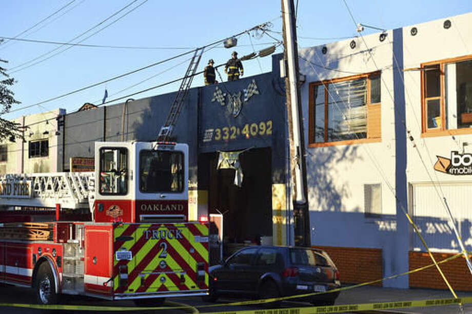 Firefighters assess the scene where a fire tore through a warehouse party early Saturday, Dec. 3, 2016 in Oakland. The blaze began at about 11:30 p.m. on Friday during a party at a warehouse in the San Francisco Bay Area city. Several people are unaccounted for. (AP Photo/Josh Edelson)