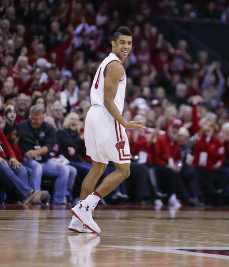 Wisconsin's D'Mitrik Trice (0) reacts after hitting a 3-point basket against Oklahoma during the second half of an NCAA college basketball game Saturday, Dec. 3, 2016, in Madison, Wis. Wisconsin won 90-70. Trice had 16 points in Wisconsin's 90-70 win. (AP Photo/Andy Manis)