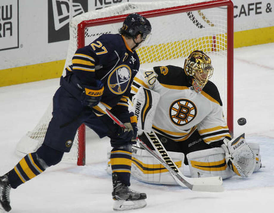 Buffalo Sabres forward Derek Grant (27) is stopped by Boston Bruins goalie Tuukka Rask (40) during the second period of an NHL hockey game, Saturday, Dec. 3, 2016, in Buffalo, N.Y. (AP Photo/Jeffrey T. Barnes)
