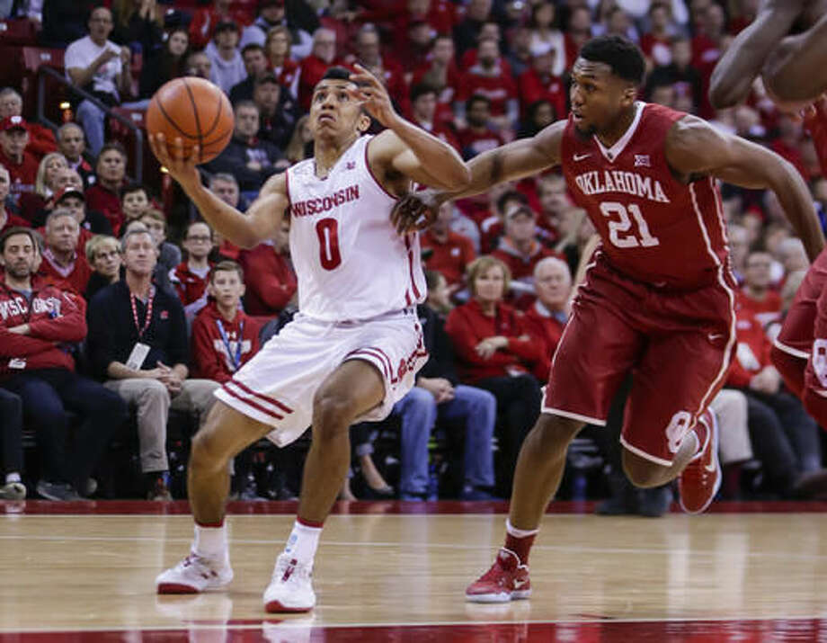 Wisconsin's D'Mitrik Trice (0) drives against Oklahoma's Dante Buford (21) during the second half of an NCAA college basketball game Saturday, Dec. 3, 2016, in Madison, Wis. Trice had 16 points in Wisconsin's 90-70 win. (AP Photo/Andy Manis)