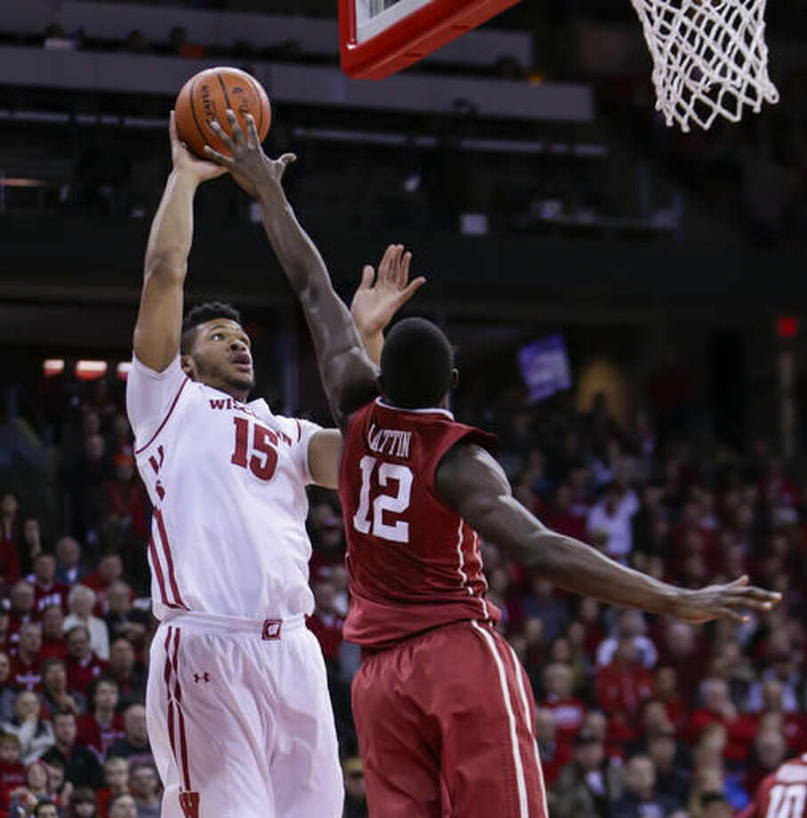 Wisconsin's Charles Thomas (15) shoots against Oklahoma's Dante Buford (21) during the second half of an NCAA college basketball game Saturday, Dec. 3, 2016, in Madison, Wis. Wisconsin won 90-70. (AP Photo/Andy Manis)