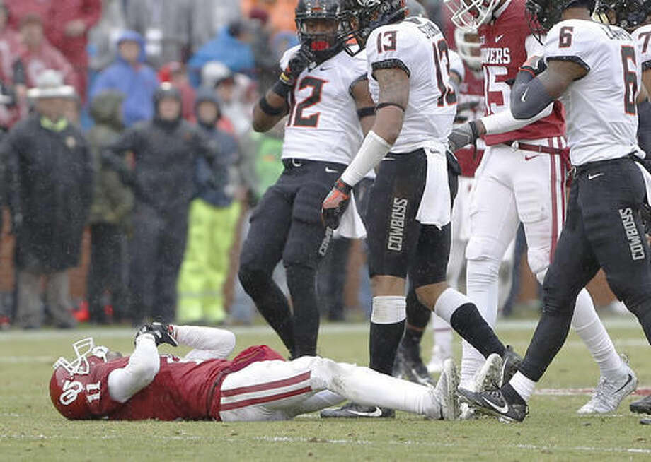 Oklahoma wide receiver Dede Westbrook (11) lays on the field after an injury in a play against Oklahoma State in the first half of an NCAA college football game, Saturday, Dec. 3, 2016, in Norman, Okla. (AP Photo/Alonzo Adams)