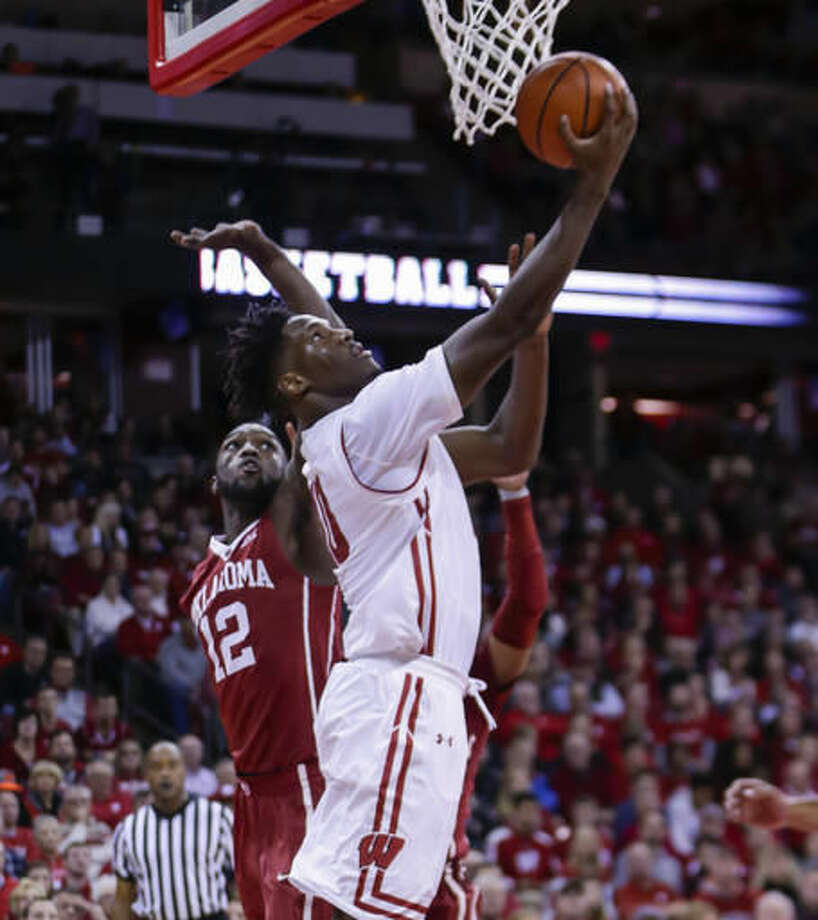 Wisconsin's Nigel Hayes (10) shoots past Oklahoma's Khadeem Lattin (12) during the second half of an NCAA college basketball game Saturday, Dec. 3, 2016, in Madison, Wis. Wisconsin won 90-70. Hayes had a game-high 28 points in Wisconsin's 90-70 win. (AP Photo/Andy Manis)