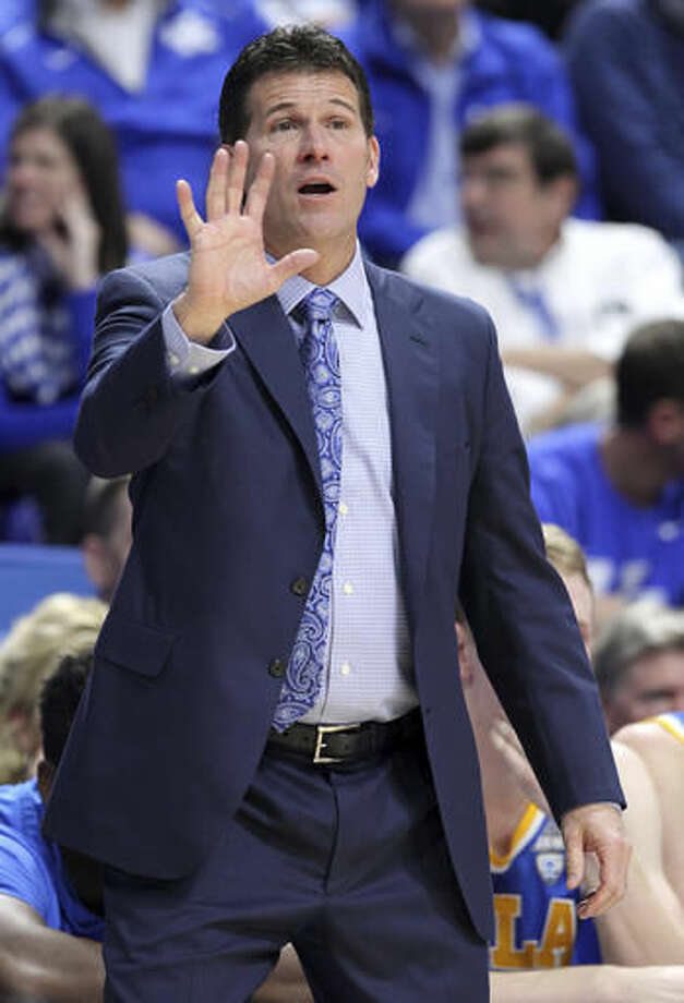 UCLA head coach Steve Alford directs his team during the first half of an NCAA college basketball game against Kentucky, Saturday, Dec. 3, 2016, in Lexington, Ky. (AP Photo/James Crisp)