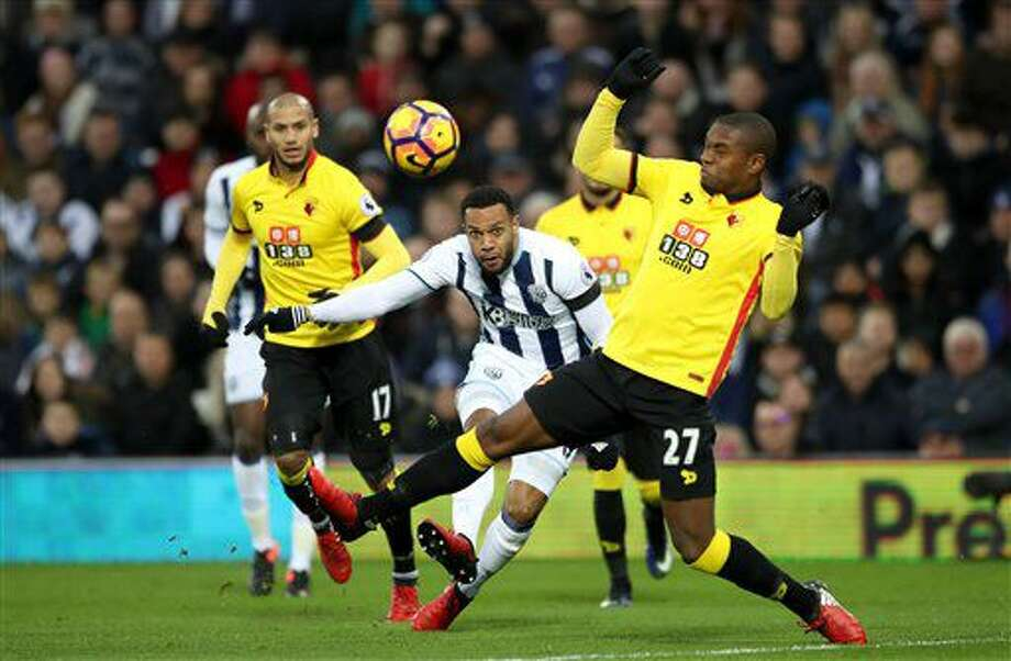 West Bromwich Albion's Matt Phillips, centre has a shot on goal, during the English Premier League soccer match between West Bromwich Albion and Watford, at The Hawthorns, in West Bromwich, England, Saturday, Dec. 3, 2016. (Nick Potts/PA via AP)