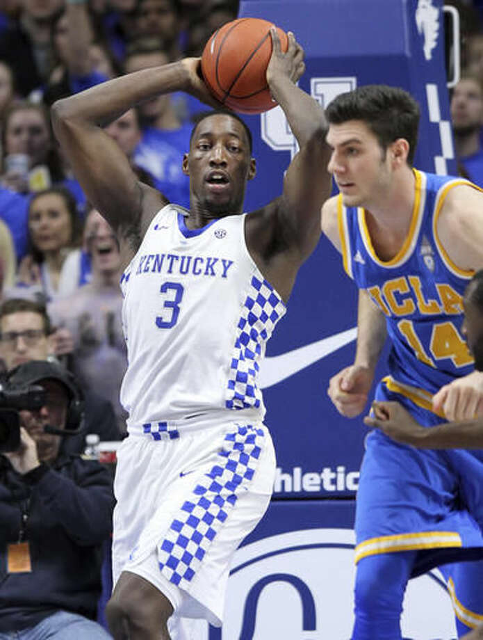 "Kentucky's Edrice ""Bam"" Adebayo (3) looks for an outlet near UCLA's Gyorgy Goloman during the first half of an NCAA college basketball game, Saturday, Dec. 3, 2016, in Lexington, Ky. (AP Photo/James Crisp)"