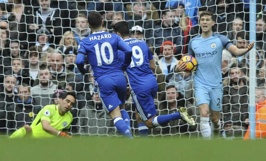Manchester City's John Stones, right, reacts as Chelsea's Diego Costa, 2nd right runs, during the the English Premier League soccer match between Manchester City and Chelsea at the Etihad Stadium in Manchester, England, Saturday, Dec. 3, 2016. (AP Photo/Rui Vieira)
