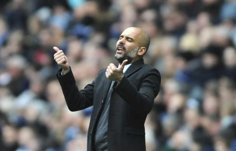 Manchester City manager Josep Guardiola reacts during the English Premier League soccer match between Manchester City and Chelsea at the Etihad Stadium in Manchester, England, Saturday, Dec. 3, 2016. (AP Photo/Rui Vieira)