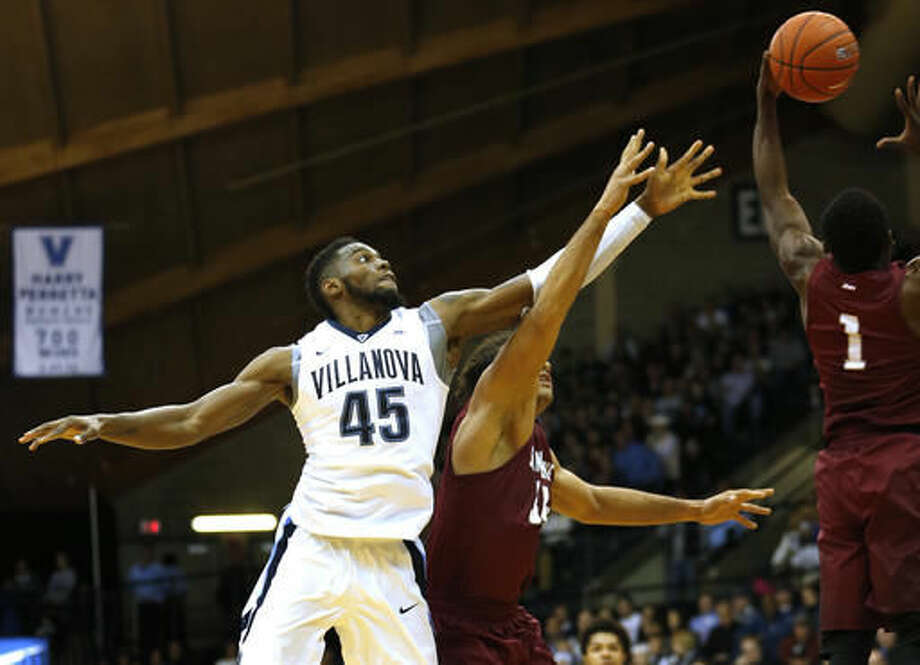 Villanova forward Darryl Reynolds (45) and Saint Joseph's forward Javon Baumann and guard Shavar Newkirk (1) reach for a rebound in the first half of an NCAA college basketball game, Saturday, Dec. 3, 2016, in Villanova, Pa. (AP Photo/Laurence Kesterson)