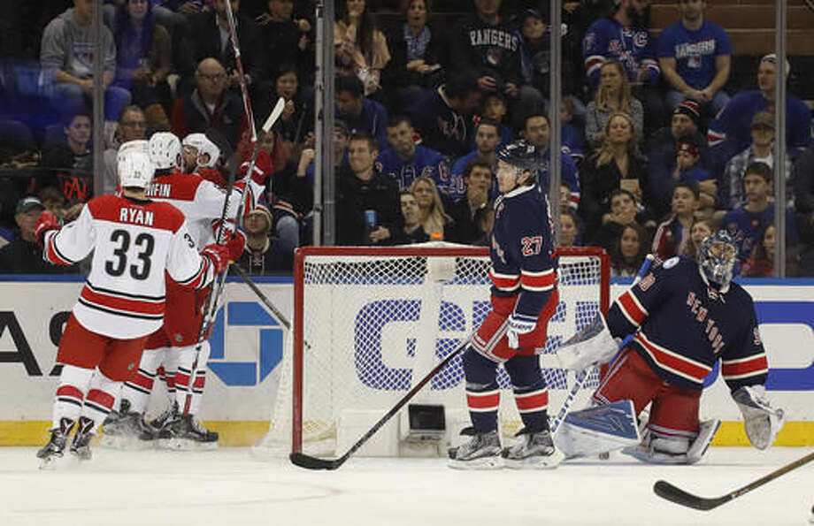 New York Rangers goalie Henrik Lundqvist (30) and defenseman Ryan McDonagh (27) react as the Carolina Hurricanes celebrate a goal by left wing Viktor Stalberg (25) during the second period of an NHL hockey game, Saturday, Dec. 3, 2016, in New York. (AP Photo/Julie Jacobson)