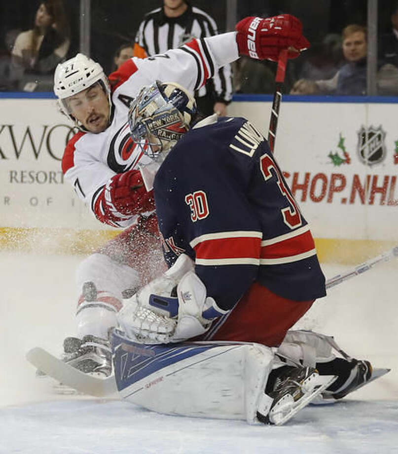 New York Rangers goalie Henrik Lundqvist (30) blocks a shot by Carolina Hurricanes defenseman Justin Faulk (27) during the first period of an NHL hockey game, Saturday, Dec. 3, 2016, in New York. (AP Photo/Julie Jacobson)