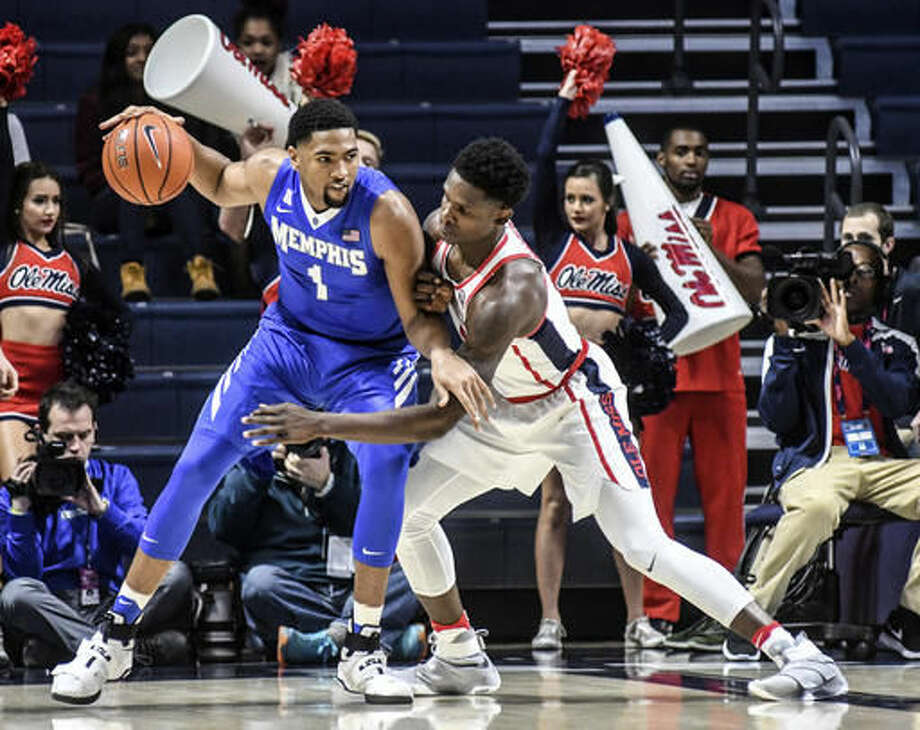 Memphis guard Dedric Lawson (1) works the ball against Mississippi Rebels forward Marcanvis Hymon (5) during the first half of an NCAA college basketball game at the Pavilion at Ole Miss in Oxford, Miss., Saturday, Dec. 3, 2016. (Bruce Newman/The Oxford Eagle via AP)