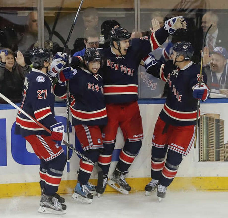 New York Rangers left wing Chris Kreider (20) celebrates with teammates after scoring a goal against the Carolina Hurricanes during the third period of an NHL hockey game, Saturday, Dec. 3, 2016, in New York. The Rangers won 4-2. (AP Photo/Julie Jacobson)