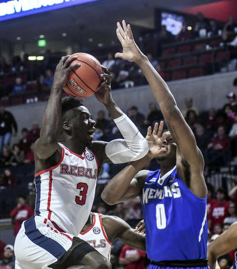 Mississippi guard Terence Davis (3) shoots against Memphis guard K.J. Lawson (0) during the first half of an NCAA college basketball game at the Pavilion at Ole Miss in Oxford, Miss., Saturday, Dec. 3, 2016. (Bruce Newman/The Oxford Eagle via AP)