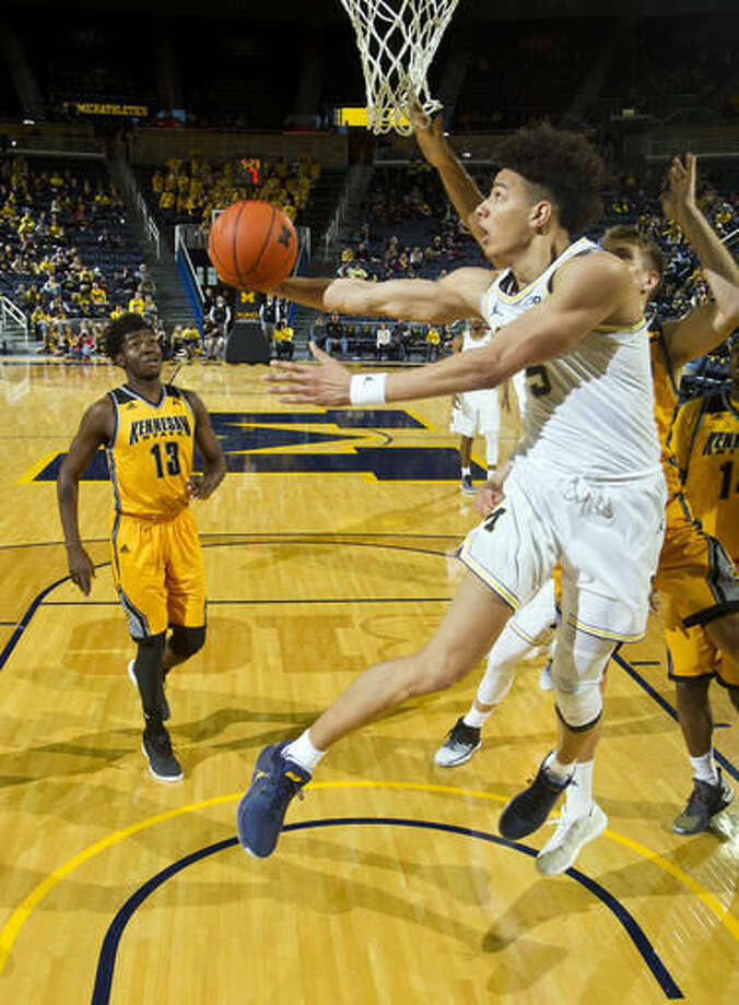 Michigan forward D.J. Wilson (5) attempts to hook in a basket in the second half of an NCAA college basketball game against Kennesaw State at Crisler Center in Ann Arbor, Mich., Saturday, Dec. 3, 2016. (AP Photo/Tony Ding)