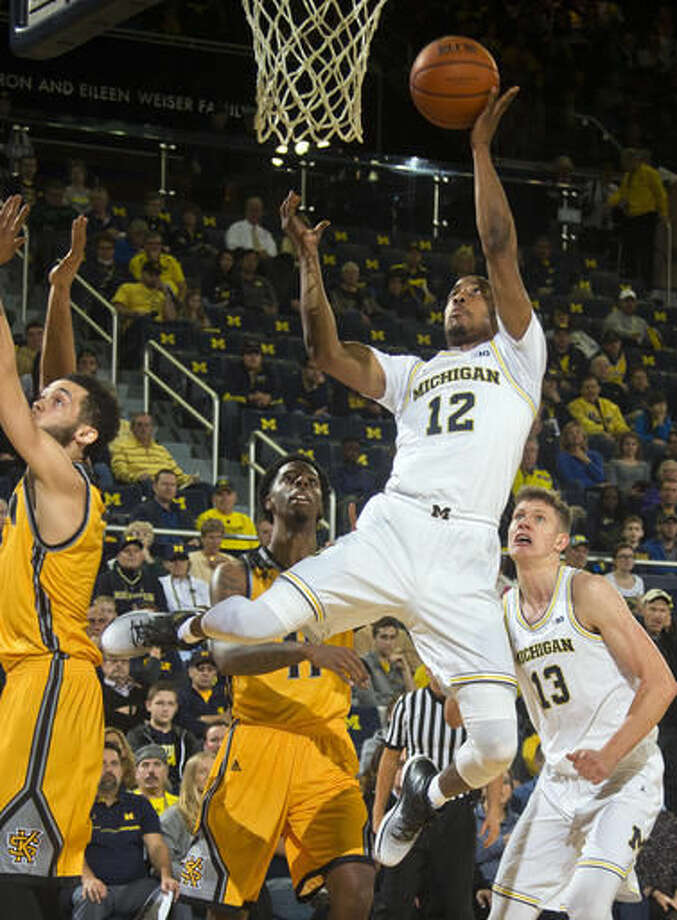 Michigan guard Muhammad-Ali Abdur-Rahkman (12) goes to the basket in the first half of an NCAA college basketball game against Kennesaw State at Crisler Center in Ann Arbor, Mich., Saturday, Dec. 3, 2016. (AP Photo/Tony Ding)