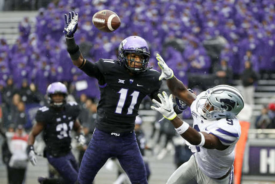 TCU cornerback Ranthony Texada (11) and Kansas State wide receiver Byron Pringle (9) go for a pass in the end zone during the first half of an NCAA college football game Saturday, Dec. 3, 2016, in Fort Worth, Texas. The pass was incomplete. (AP Photo/Ron Jenkins)