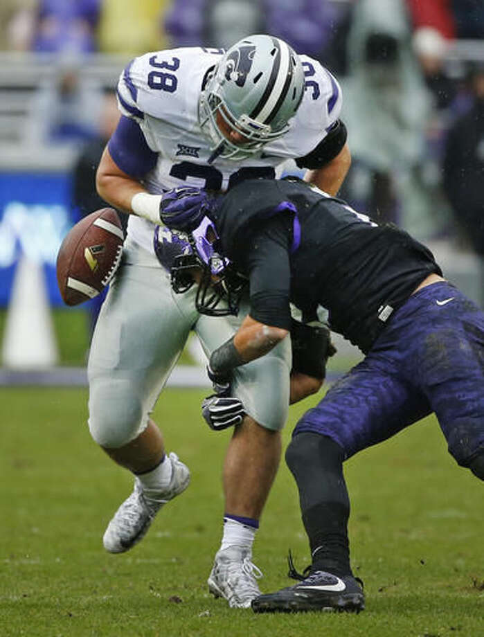 Kansas State fullback Winston Dimel (38) fumbles after being hit by TCU safety Niko Small (2) during the first half of an NCAA college football game Saturday, Dec. 3, 2016, in Fort Worth, Texas. TCU recovered on the play. (AP Photo/Ron Jenkins)