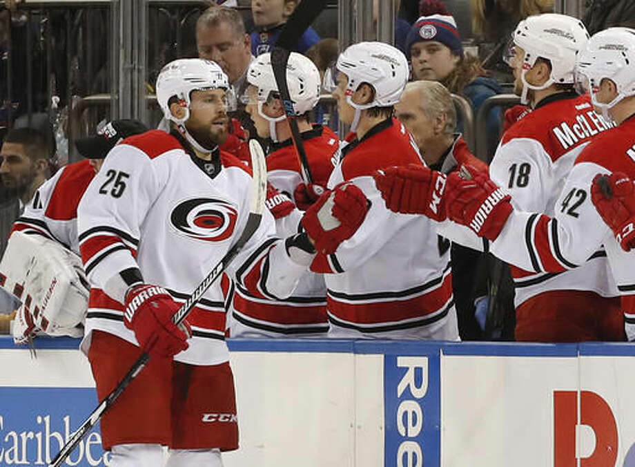 Carolina Hurricanes left wing Viktor Stalberg (25) is congratulated by teammates after scoring a goal against the New York Rangers during the second period of an NHL hockey game, Saturday, Dec. 3, 2016, in New York. (AP Photo/Julie Jacobson)