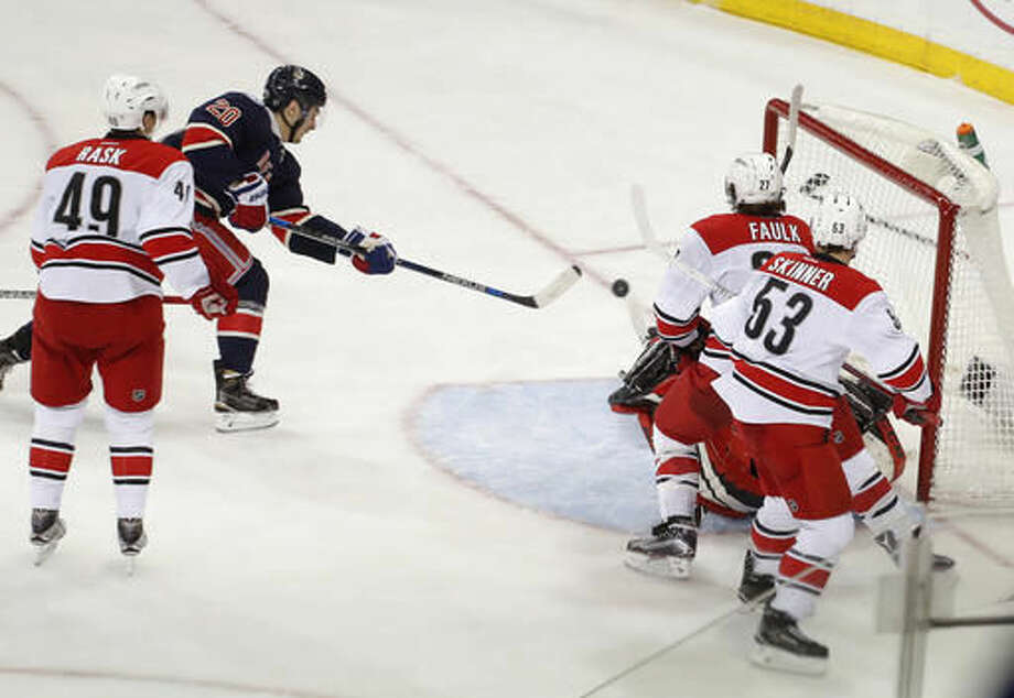 New York Rangers left wing Chris Kreider (20) shoots and scores against the Carolina Hurricanes during the third period of an NHL hockey game, Saturday, Dec. 3, 2016, in New York. The Rangers won 4-2. (AP Photo/Julie Jacobson)