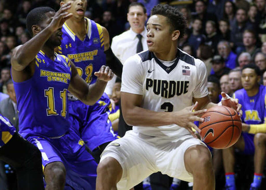 Purdue guard Carsen Edwards, right, looks to pass the basketball defended by Morehead State guard Malik Maitland in the first half of an NCAA college basketball game, Saturday, Dec. 3, 2016, in West Lafayette, Ind. (AP Photo/R Brent Smith)