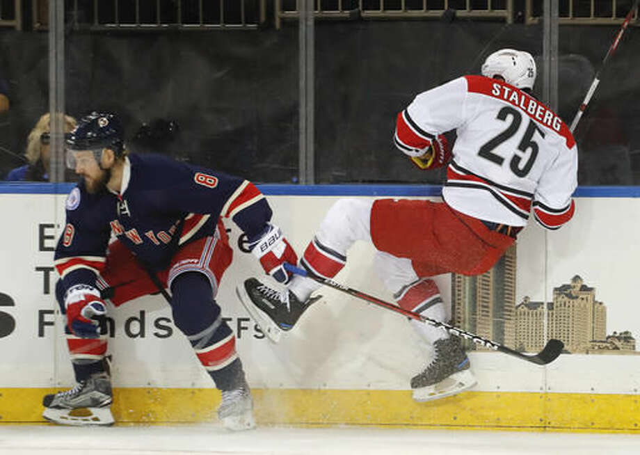 Carolina Hurricanes left wing Viktor Stalberg (25) collides with New York Rangers defenseman Kevin Klein (8) during the first period of an NHL hockey game, Saturday, Dec. 3, 2016, in New York. (AP Photo/Julie Jacobson)