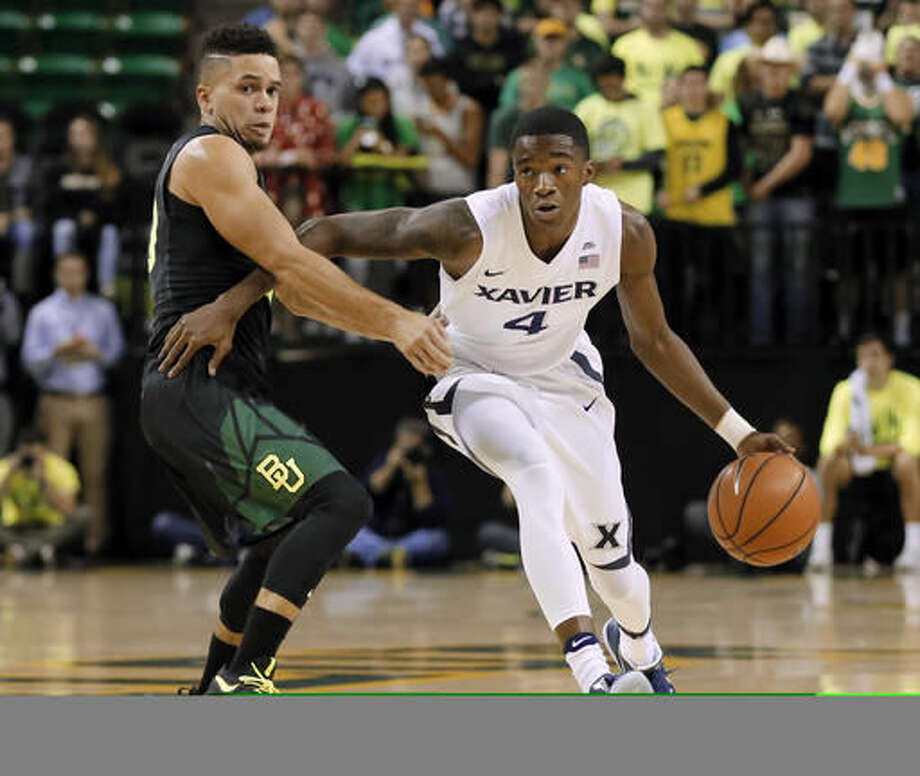 Baylor guard Manu Lecomte, left, of Belgium defends as Xavier guard Edmond Sumner (4) moves the ball upcourt in the first half of an NCAA college basketball game, Saturday, Dec. 3, 2016, in Waco, Texas. (AP Photo/Tony Gutierrez)