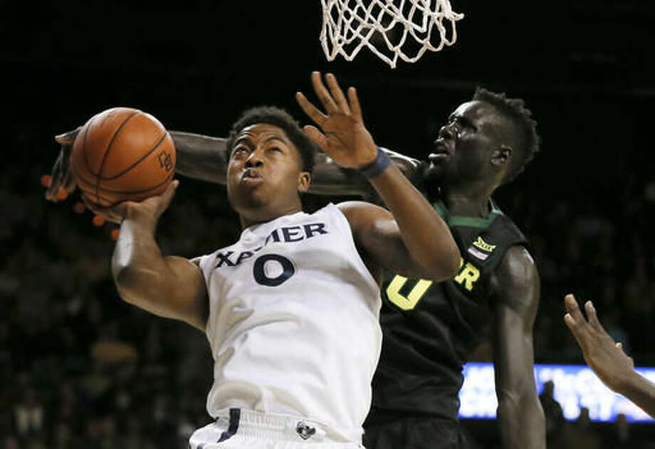 Xavier forward Tyrique Jones (0) has his shot blocked by Baylor forward Jo Lual-Acuil Jr., right, of Australia, during the first half of an NCAA college basketball game, Saturday, Dec. 3, 2016, in Waco, Texas. (AP Photo/Tony Gutierrez)