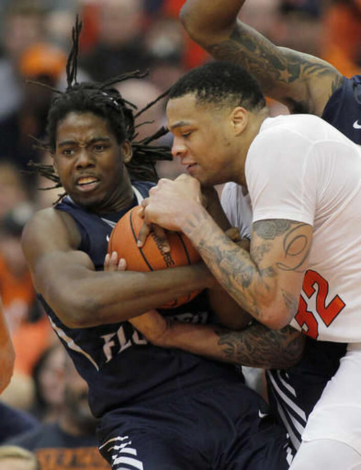 North Florida's Wajid Aminu, left, and Syracuse's Dajuan Coleman, right, battle for a loose ball in the first half of an NCAA college basketball game in Syracuse, N.Y., Saturday, Dec. 3, 2016. (AP Photo/Nick Lisi)