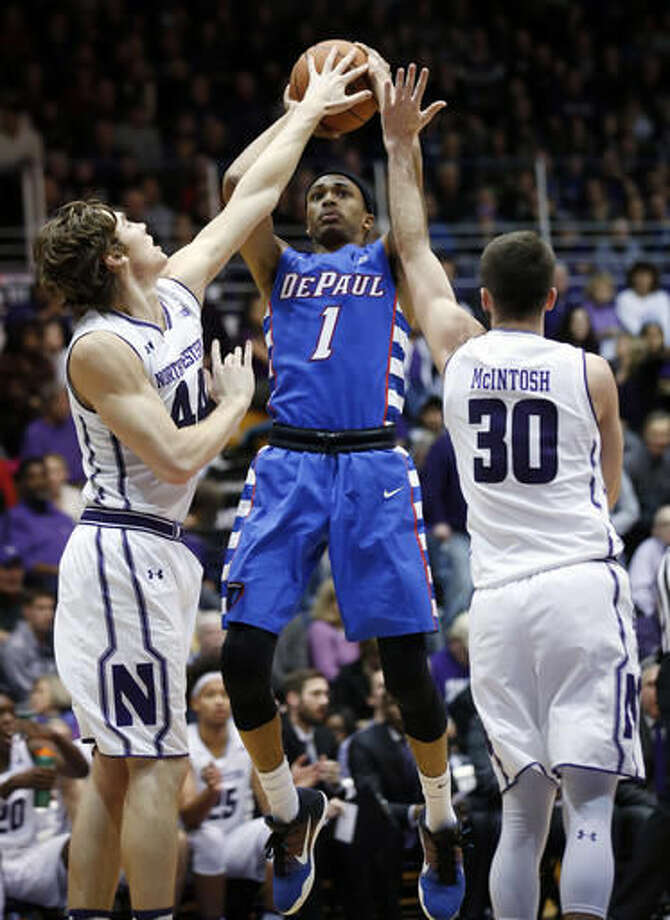 Northwestern forward Gavin Skelly, left, and guard Bryant McIntosh, right, defend DePaul guard Darrick Wood (1) during the first half of an NCAA college basketball game Saturday, Dec. 3, 2016, in Evanston, Ill. (AP Photo/Nam Y. Huh)