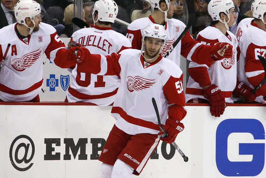 Detroit Red Wings' Frans Nielsen (51) celebrates with teammates after his goal in the second period of an NHL hockey game against the Pittsburgh Penguins in Pittsburgh, Saturday, Dec. 3, 2016. (AP Photo/Gene J. Puskar)
