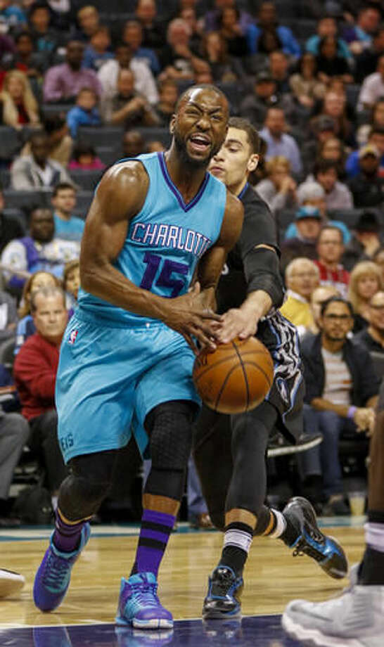 Charlotte Hornets guard Kemba Walker, left, has the basketball stripped by Minnesota Timberwolves guard Zach LaVine in the first half of an NBA basketball game in Charlotte, N.C., Saturday, Dec. 3, 2016. (AP Photo/Nell Redmond)