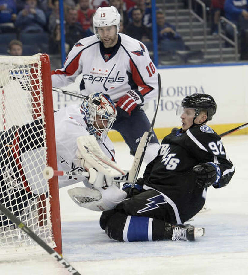 Tampa Bay Lightning right wing Joel Vermin (92) slides into Washington Capitals goalie Braden Holtby (70) during the second period of an NHL hockey game Saturday, Dec. 3, 2016, in Tampa, Fla. (AP Photo/Jason Behnken)