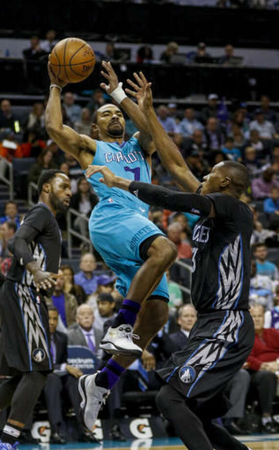Charlotte Hornets guard Ramon Sessions, left, shoots over Minnesota Timberwolves forward Gorgui Dieng, of Senegal, in a NBA basketball game in Charlotte, N.C., Saturday, Dec. 3, 2016. (AP Photo/Nell Redmond)