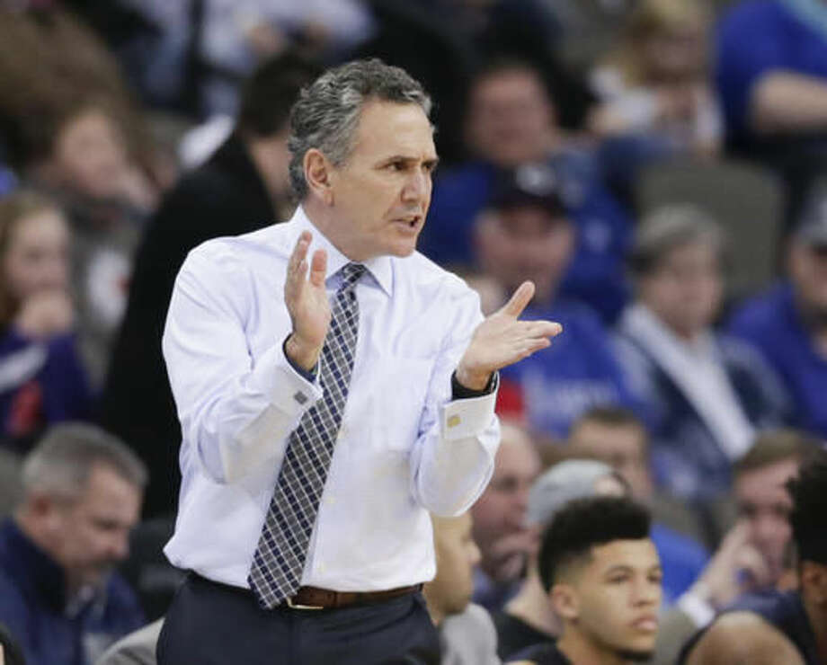 Akron coach Keith Dambrot cheers his players during the first half of an NCAA college basketball game against Creighton in Omaha, Neb., Saturday, Dec. 3, 2016. (AP Photo/Nati Harnik)