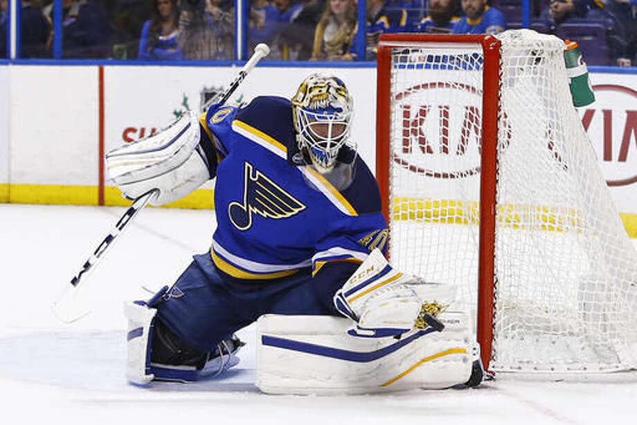 St. Louis Blues goalie Carter Hutton makes a save during the first period of an NHL hockey game against the Winnipeg Jets, Saturday, Dec. 3, 2016, in St. Louis. (AP Photo/Billy Hurst)