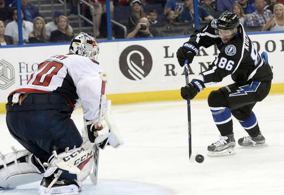 Washington Capitals goalie Braden Holtby (70) stops a shot by Tampa Bay Lightning right wing Nikita Kucherov (86) during the second period of an NHL hockey game Saturday, Dec. 3, 2016, in Tampa, Fla. (AP Photo/Jason Behnken)