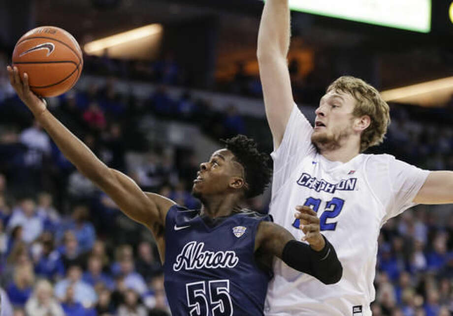 Akron's Antino Jackson (55) goes to the basket in front of Creighton's Toby Hegner (32) during the first half of an NCAA college basketball game in Omaha, Neb., Saturday, Dec. 3, 2016. (AP Photo/Nati Harnik)