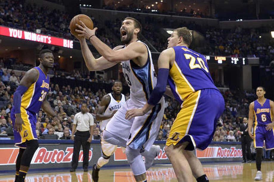 Memphis Grizzlies center Marc Gasol (33) drives against Los Angeles Lakers center Timofey Mozgov (20) in the second half of an NBA basketball game Saturday, Dec. 3, 2016, in Memphis, Tenn. (AP Photo/Brandon Dill)