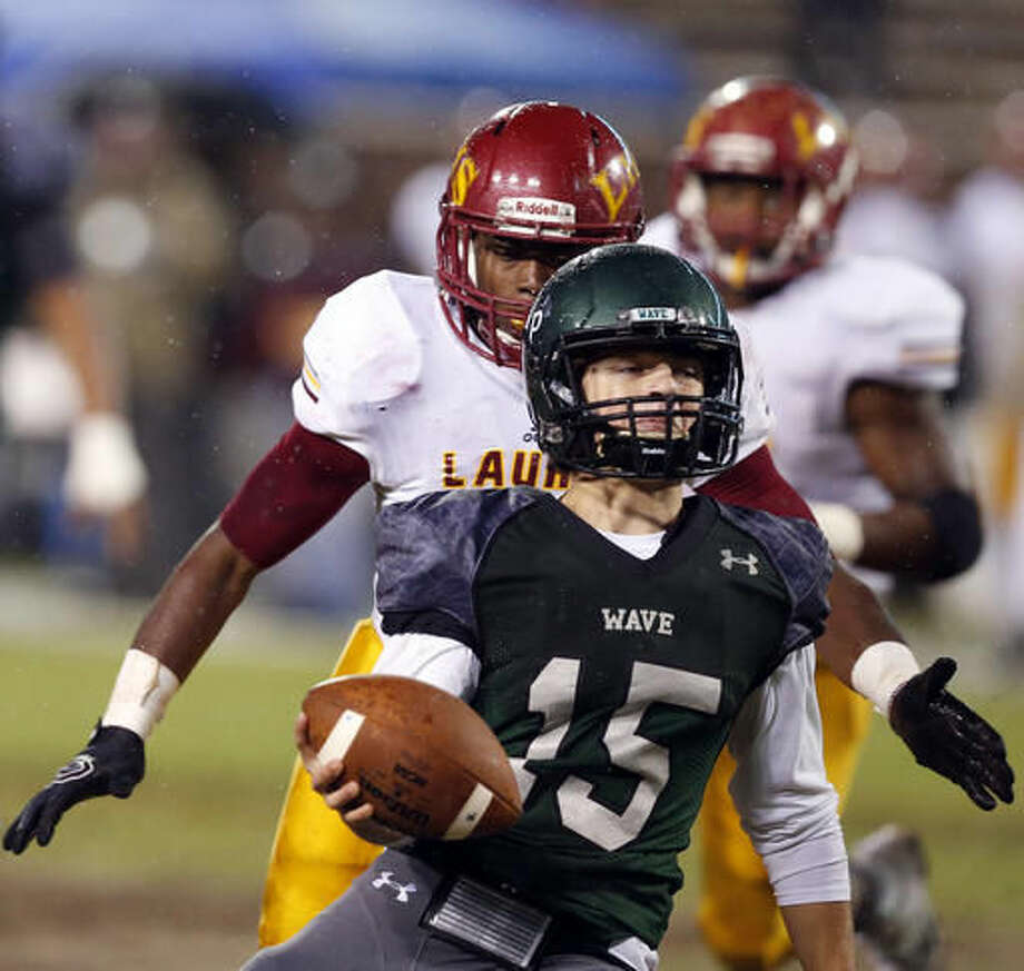 West Point wide receiver Travis Shade (15) is pursued by Laurel defenders during the first half of their MHSAA Class 5A football championship game, in Starkville, Miss., Saturday, Dec. 3, 2016. (AP Photo/Rogelio V. Solis)