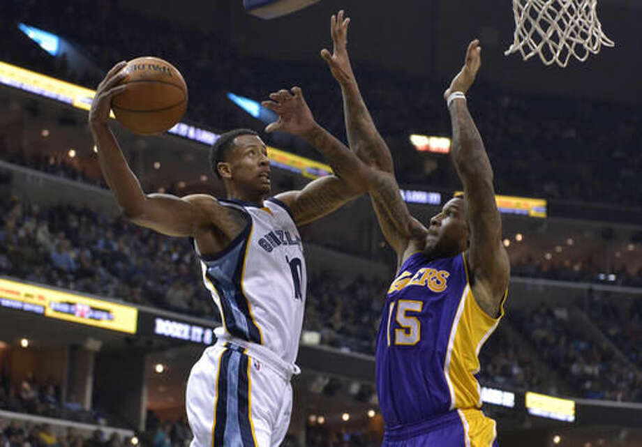 Memphis Grizzlies forward Troy Williams (10) shoots against Los Angeles Lakers forward Thomas Robinson (15) in the second half of an NBA basketball game Saturday, Dec. 3, 2016, in Memphis, Tenn. (AP Photo/Brandon Dill)