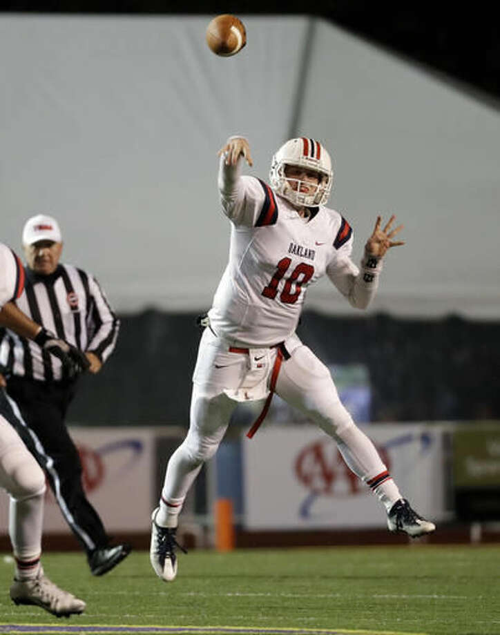 Oakland High School quarterback Brendan Matthews passes against Whitehaven High School during the first half of the Division I Class 6A Tennessee high school football championship game Saturday, Dec. 3, 2016, in Cookeville, Tenn. (AP Photo/Mark Humphrey)