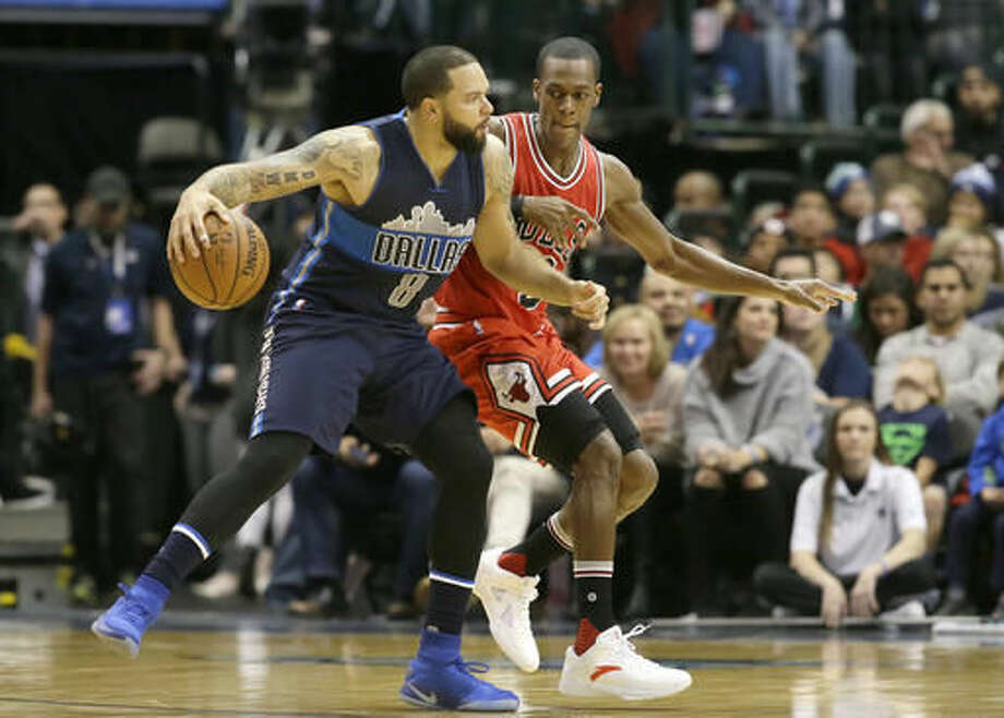 Dallas Mavericks guard Deron Williams (8) dribbles against Chicago Bulls guard Rajon Rondo during the first half of an NBA basketball game in Dallas, Saturday, Dec. 3, 2016. (AP Photo/LM Otero)