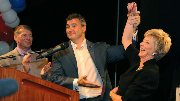 Shane McMahon raises his mom Linda McMahon's arm up in victory as she clinched the nomination for US Senate during the GOP convention in downtown Hartford, Conn. on Friday May 21, 2010. Photo: Christian Abraham / Connecticut Post