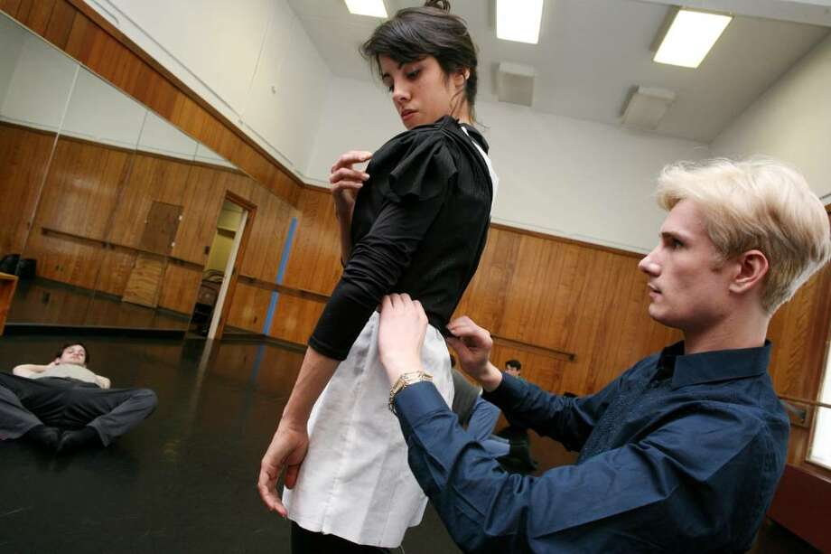 "Austin Scarlett, star of Bravo's first season of ""Project Runway,"" works on the custome of dancer Yara Travieso at the Greenwich Art Center Friday afternoon. Photo: David Ames, David Ames/For Greenwich Time / Greenwich Time"
