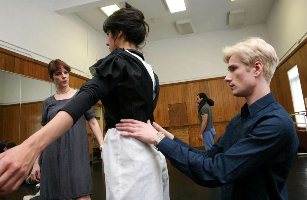 """Austin Scarlett, star of Bravo's first season of """"Project Runway,"""" works on the costume of dancer Yara Travieso at the Greenwich Arts Center Friday afternoon as head draper Mieke Aangeenbrug Knight looks on."""